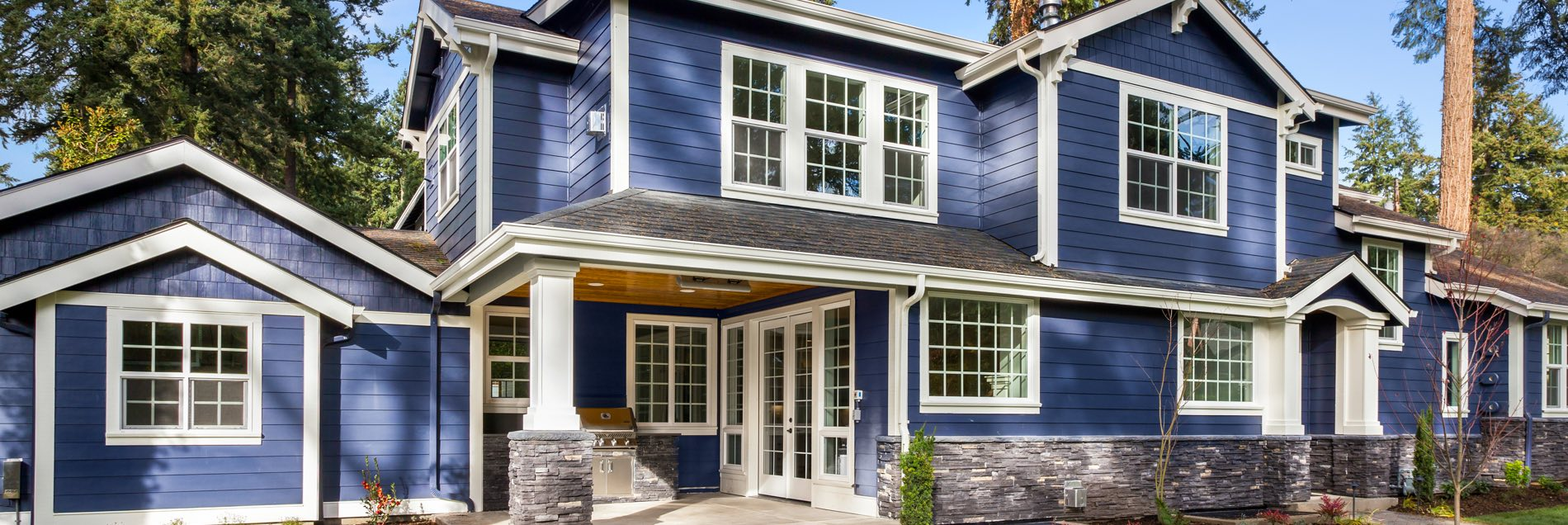 Blue home on wooded lot